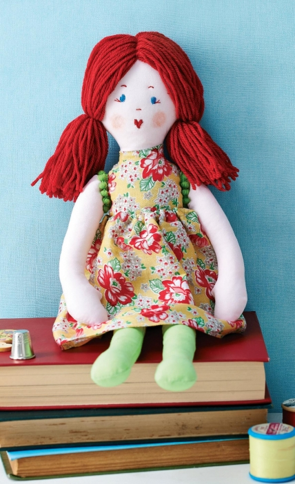 Sew a handmade red haired rag doll