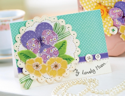 http://www.sewmag.co.uk/free-sewing-patterns/floral-brooch-and-card-for-mum